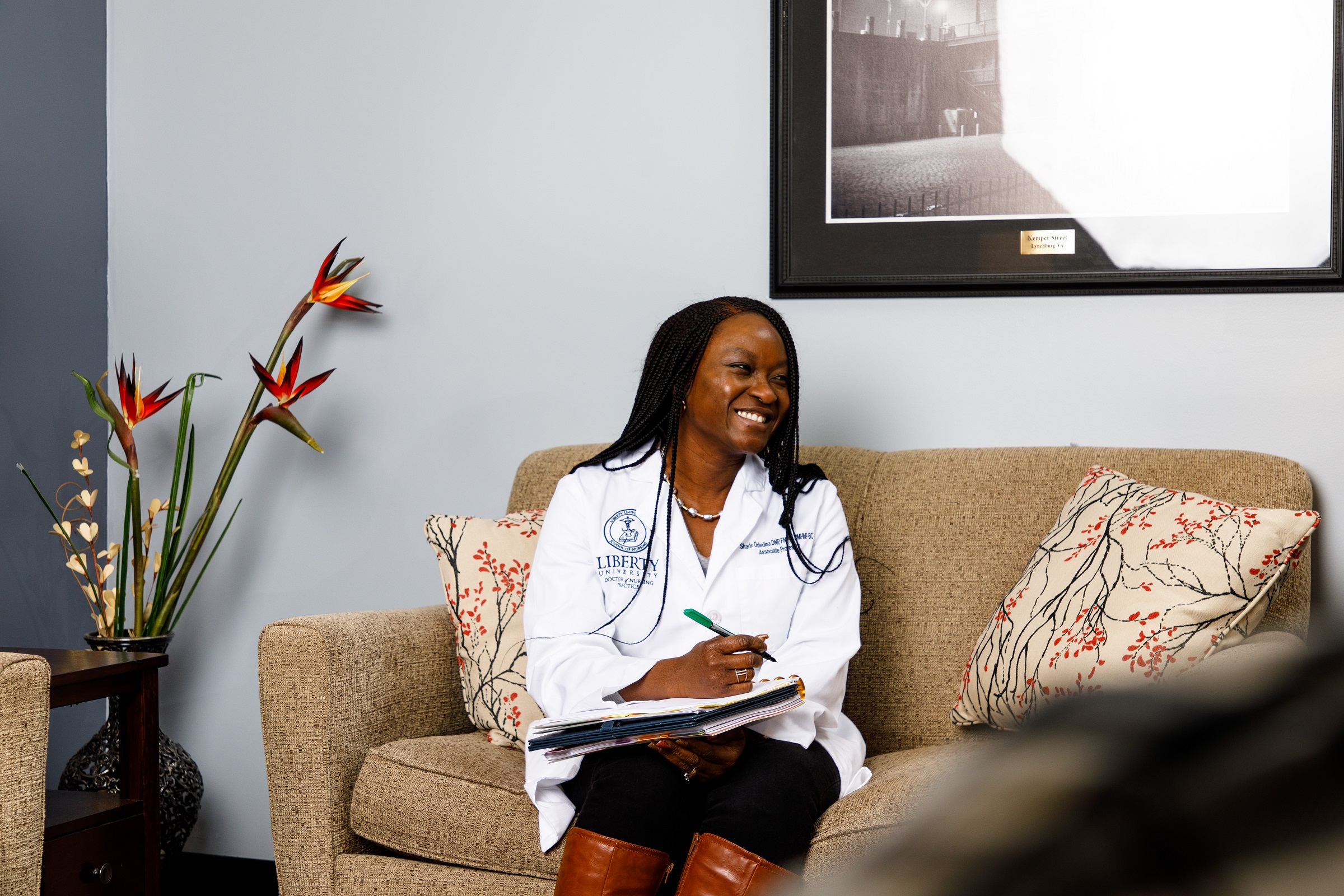 Female Nurse Practitioner in a Counseling Setting